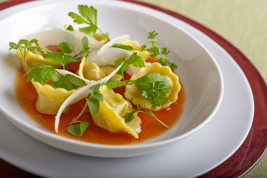 Eggplant and Ricotta Tortelli with Smoked Tomato Brodo, Fine Herbs