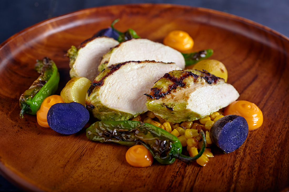 Herb Roasted Chicken Breast with Sweet Brentwood Corn, Marble Potatoes, Shishito Peppers