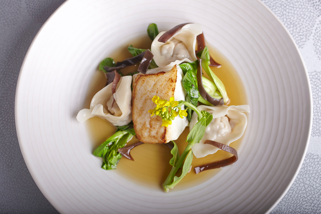 Pan-Seared Alaskan Halibut with Chicken and Dungeness Crab Dumplings